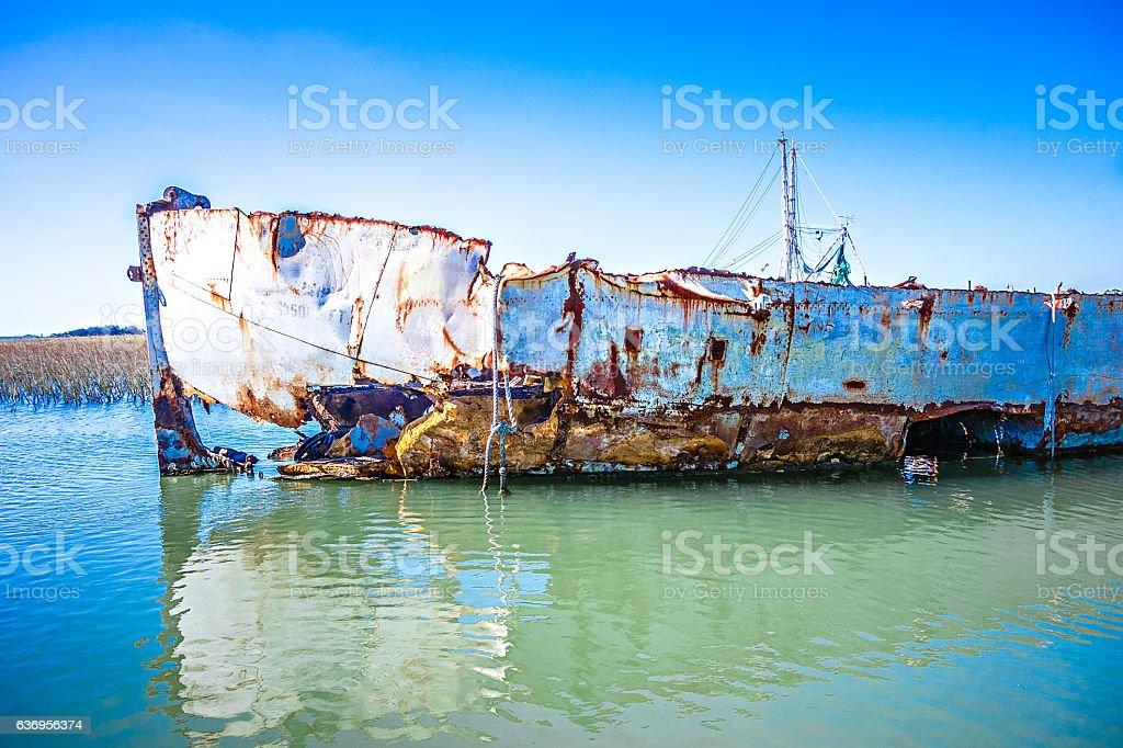 abandoned fishing and shrimp boat near folly beach south carolin stock photo