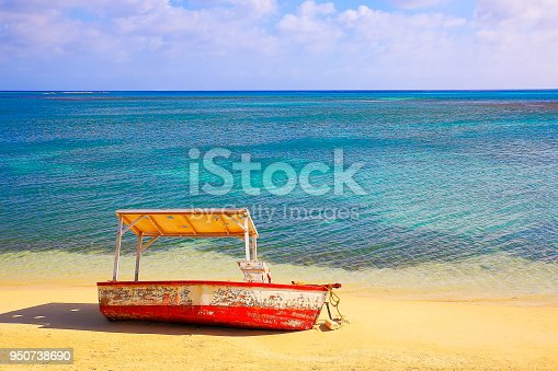 Abandoned Fishing boat stranded and  shipwreck in idyllic caribbean Beach