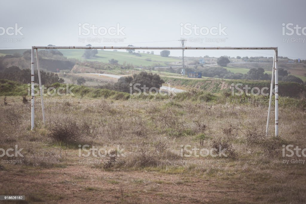 abandoned football soccer field goal stock photo