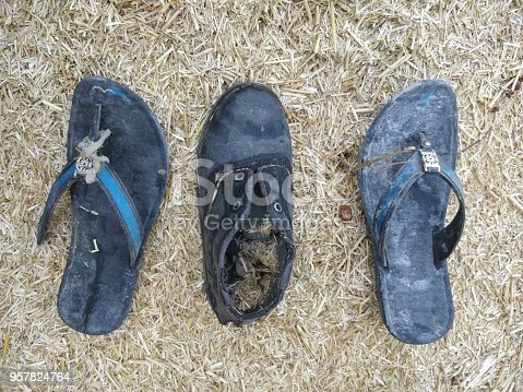 959792752 istock photo Abandoned footwear on beach 957824764