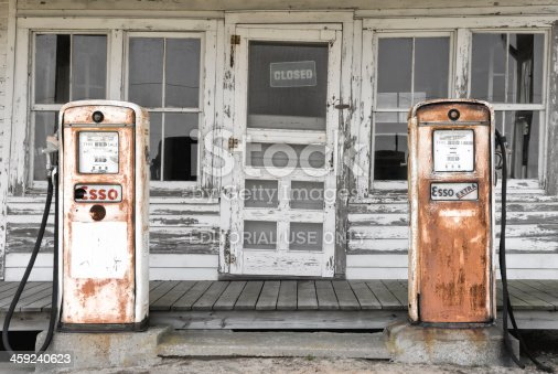 Ricketts, North Carolina, USA - May 21, 2007: Abandoned gas pumps in front of a closed down old country store, antiques rusty and forgotten.