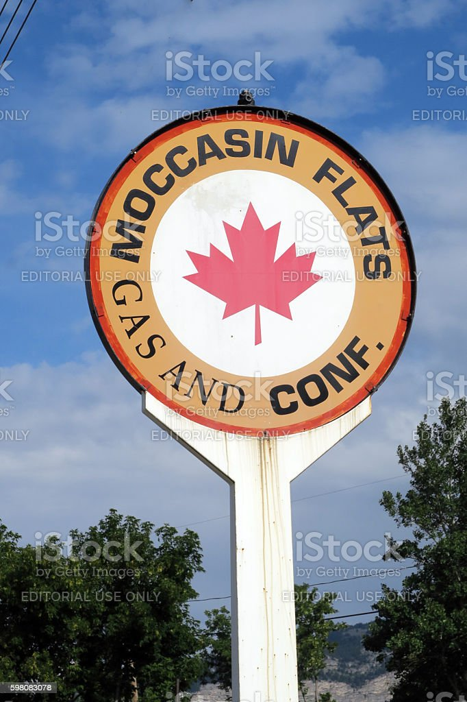 Abandoned gas station sign closed since the 1990's. stock photo
