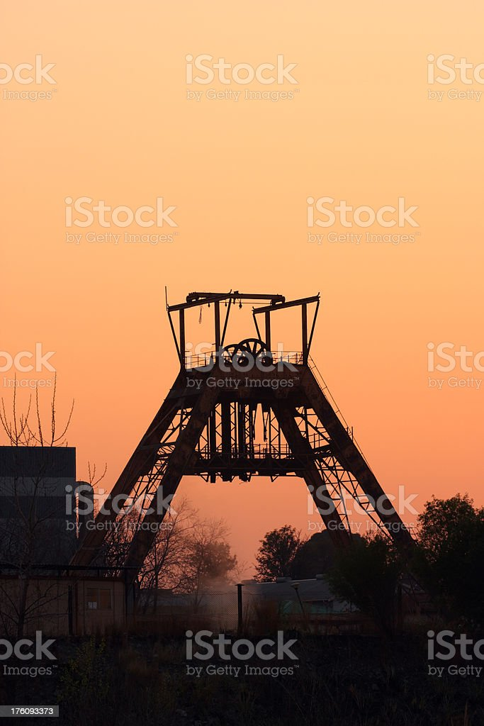 abandoned gold mine head gear in south africa at sunset royalty-free stock photo