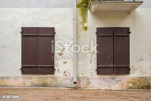 istock abandoned grunge house with closed shutters 813972656