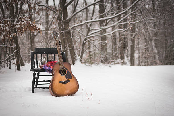 Abandoned Guitar in the Snow stock photo
