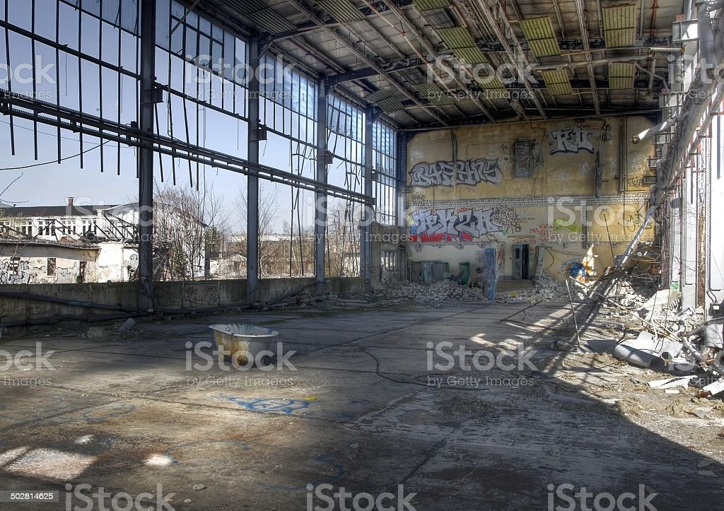 Abandoned hall with a tub stock photo