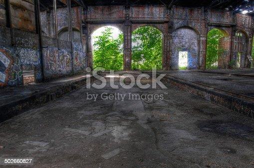 istock Abandoned hall with open doors 502660827