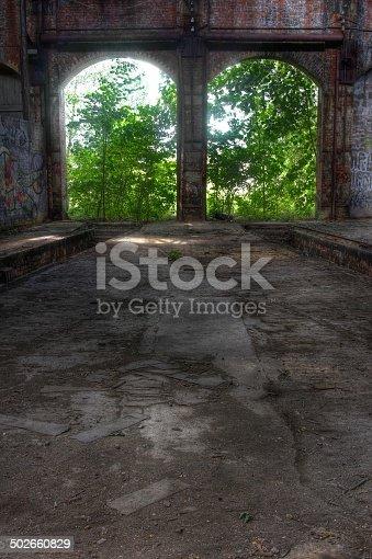 istock Abandoned hall with open doors 502660829