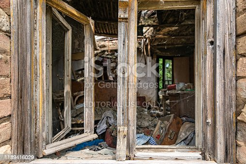 1164292968 istock photo Abandoned home. Damaged house after earthquake. 1189416029