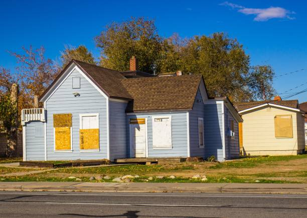 Abandoned Home With Boarded Up Doors & Windows stock photo