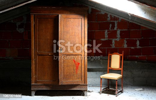 abandoned house with wooden closet and old chair