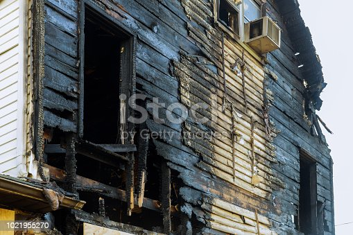 1015604978 istock photo Abandoned house completely consumed by fire is burnt to the ground after fire 1021955270