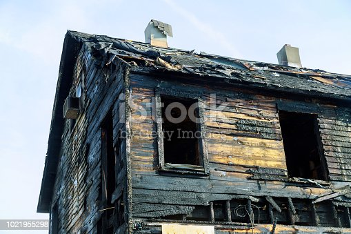1015604978 istock photo Abandoned house completely consumed by fire is burnt to the ground after fire 1021955298