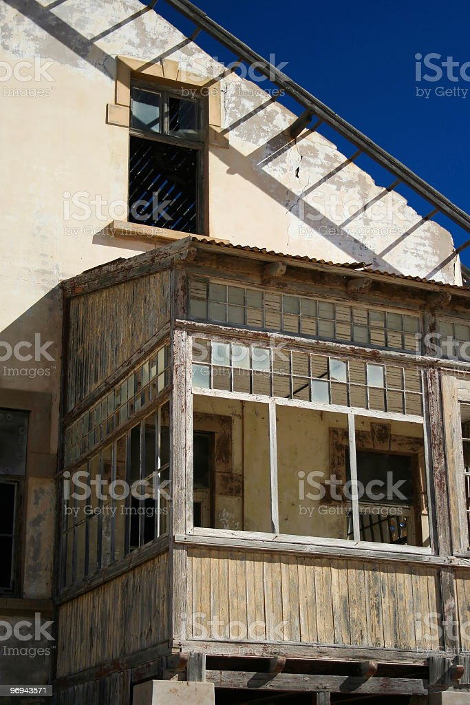 Abandoned house in Kolmanskop royalty-free stock photo