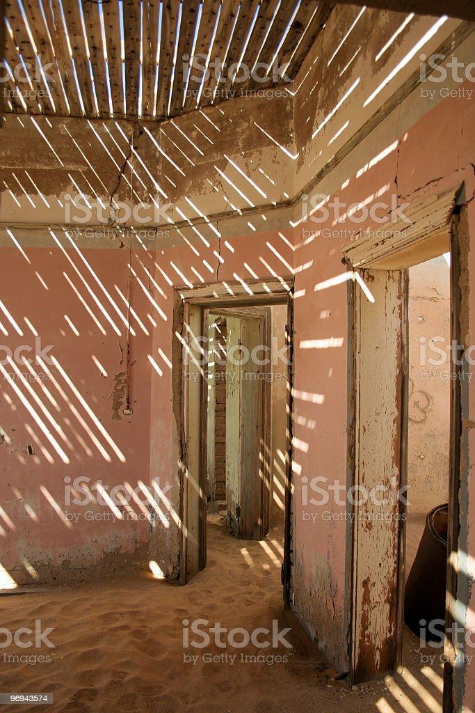 Abandoned house in Kolmanskop royalty-free stock photo