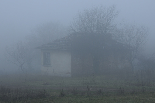 Abandoned house in snowless winter