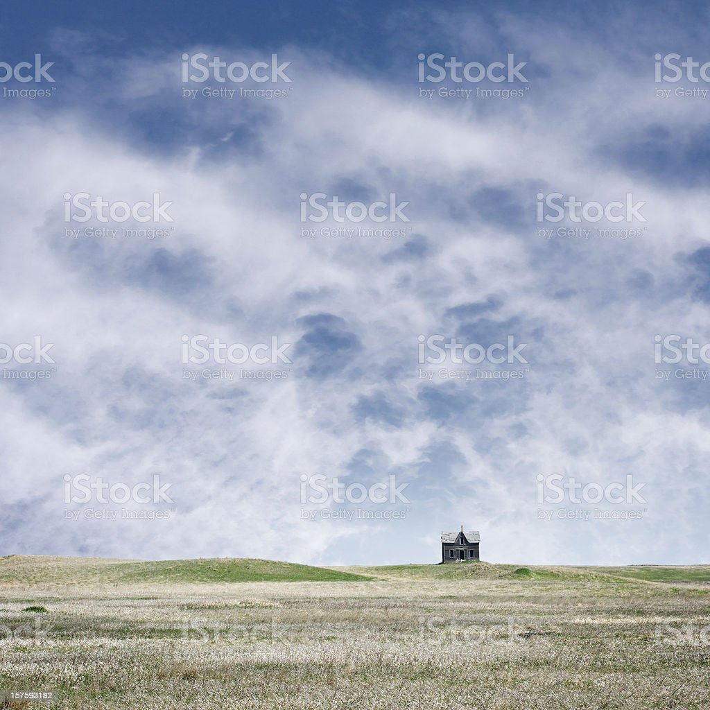 abandoned house on rolling prairie landscape royalty-free stock photo