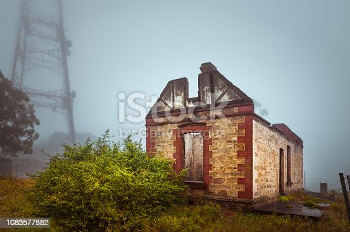 Abandoned house ruins in fog creepy countryside landscape