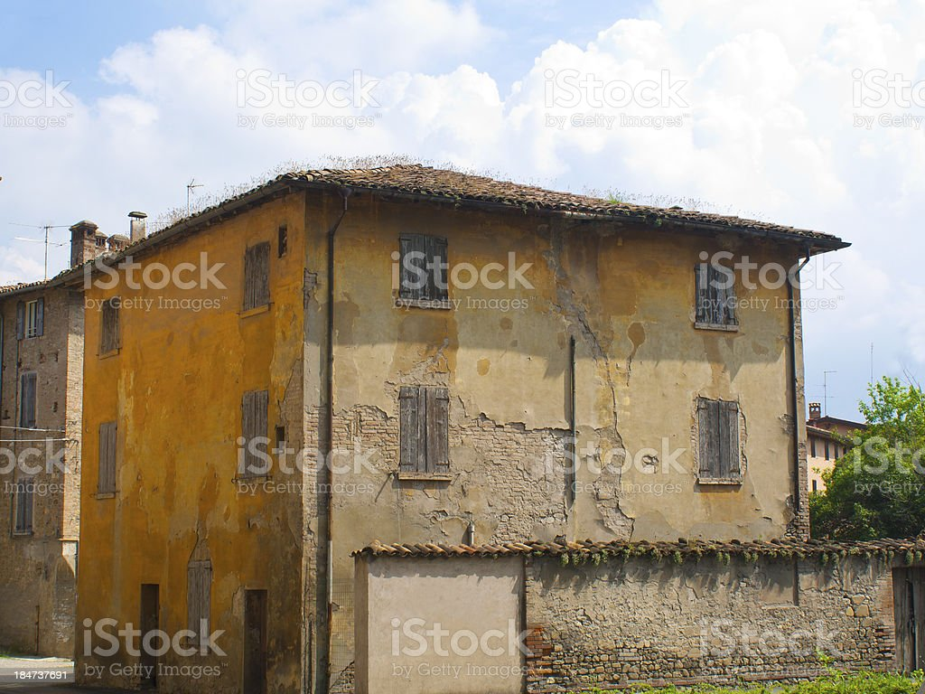 Abandoned house still maintains its earthly color stock photo