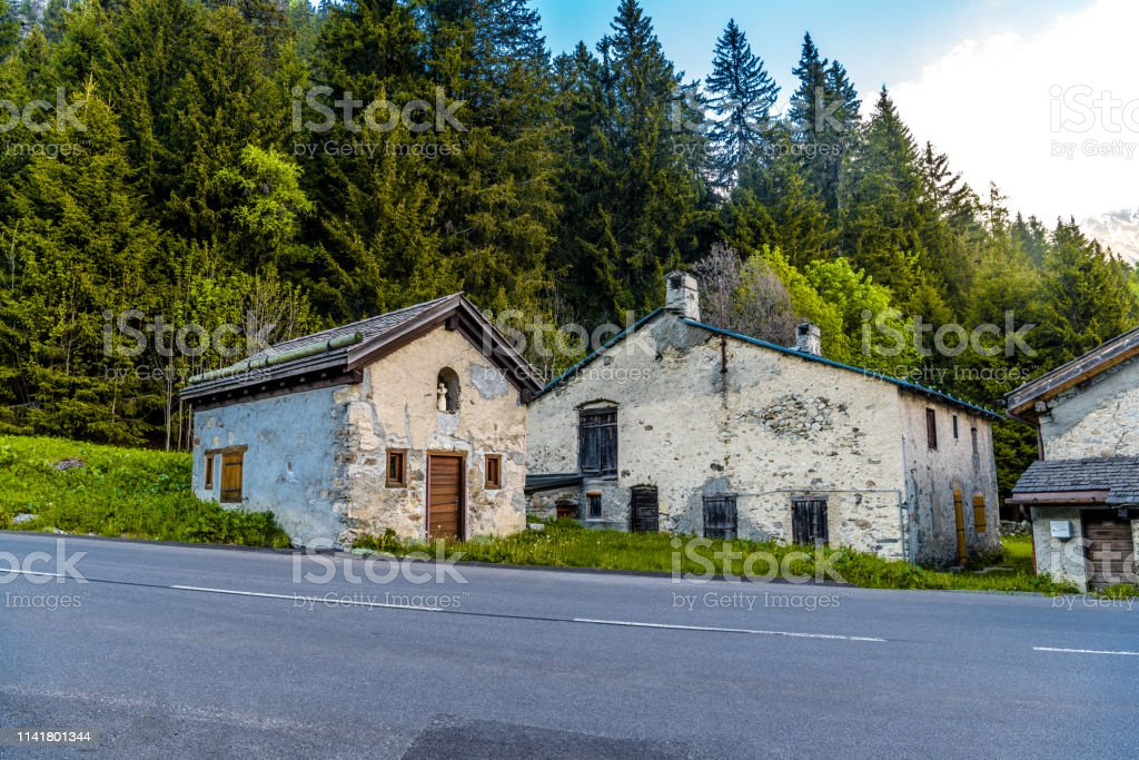 Abandoned Houses Near Road And Forest Chamonix Mont Blanc Haut Stock Photo  - Download Image Now