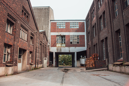 An abandoned industrial site with brick walls