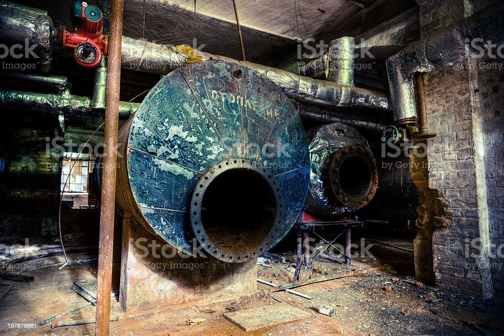 Abandoned Industrial Building Basement With Tanks and Tubes royalty-free stock photo