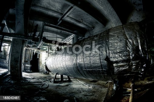 istock Abandoned Industrial Building Basement With Tanks and Tubes 183040461