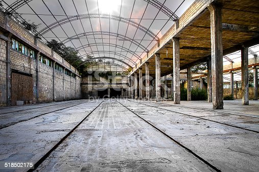 istock Abandoned Industrial interior 518502175