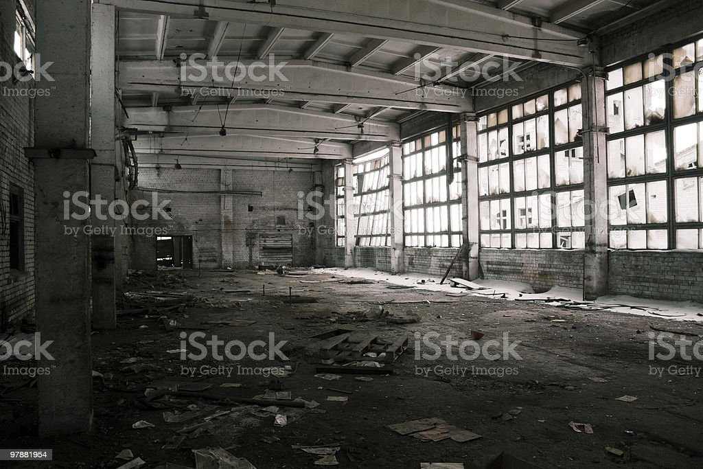 Abandoned industrial warehouse interior, black and white royalty-free stock photo
