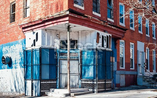 Abandoned inner city corner store and row houses.