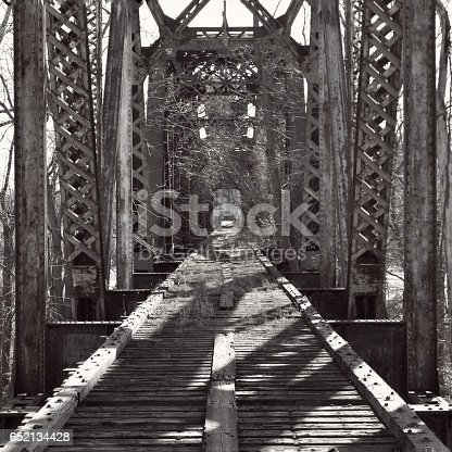Looking down the abandoned and overgrown Katy Bridge, a lift span railroad bridge over the Missouri River, in Boonville Missouri.