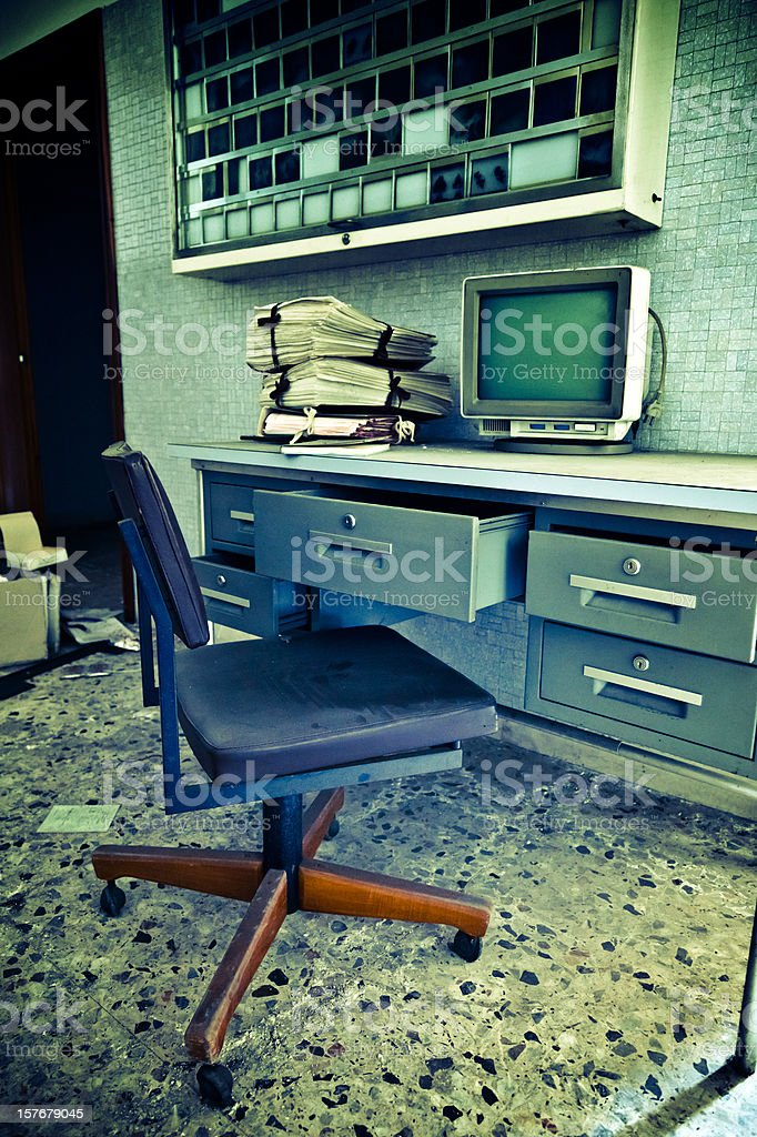 Abandoned Medical Office From The 70s Retro Computer and Documents stock photo