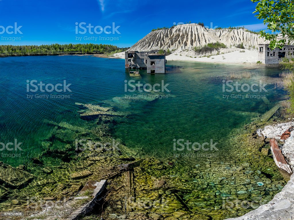 Abandoned mine, house, lake, mountain. Quarry and old prison architecture. stock photo