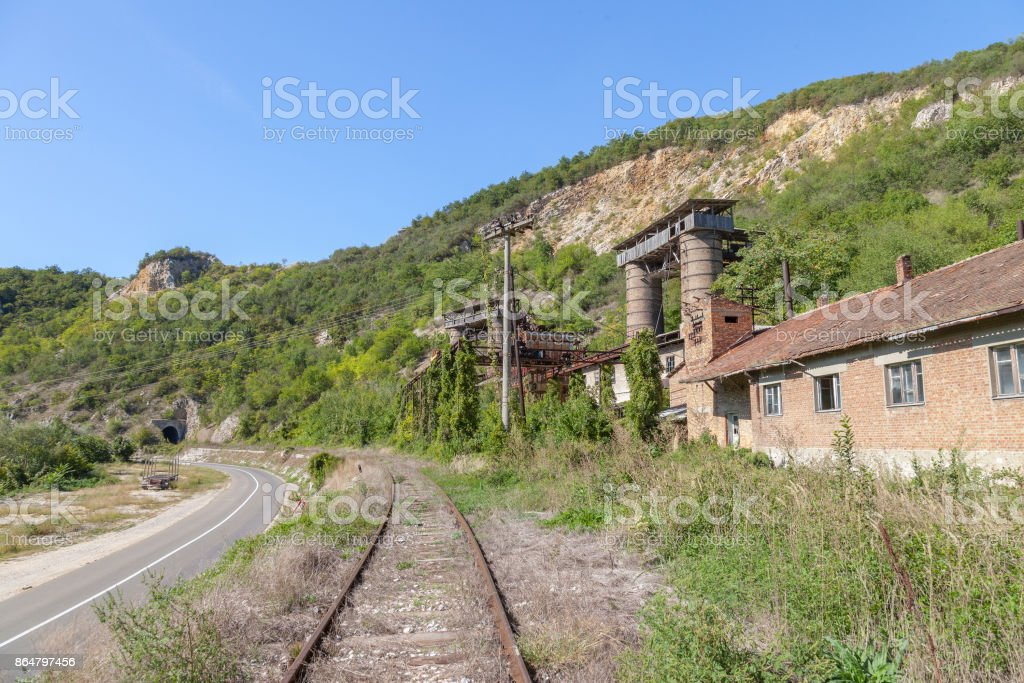 Abandoned mine - quarry near an abandoned railway line in Kucevo, eastern Serbia. Buildings and industrial installations are left to decay stock photo