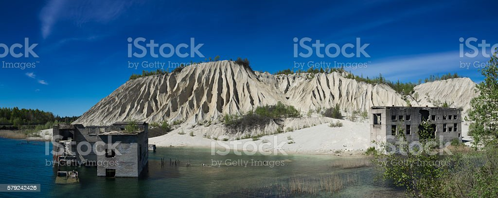 Abandoned mines and hauses. Quarry and old prison architecture. stock photo