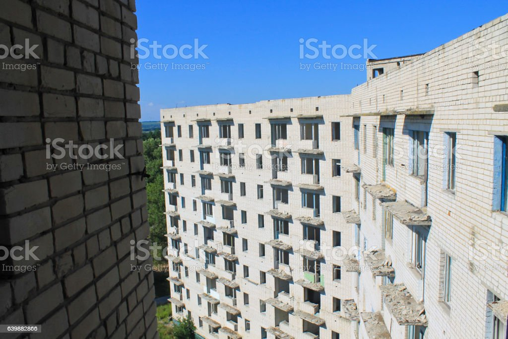 Abandoned multistory building in Ukraine stock photo