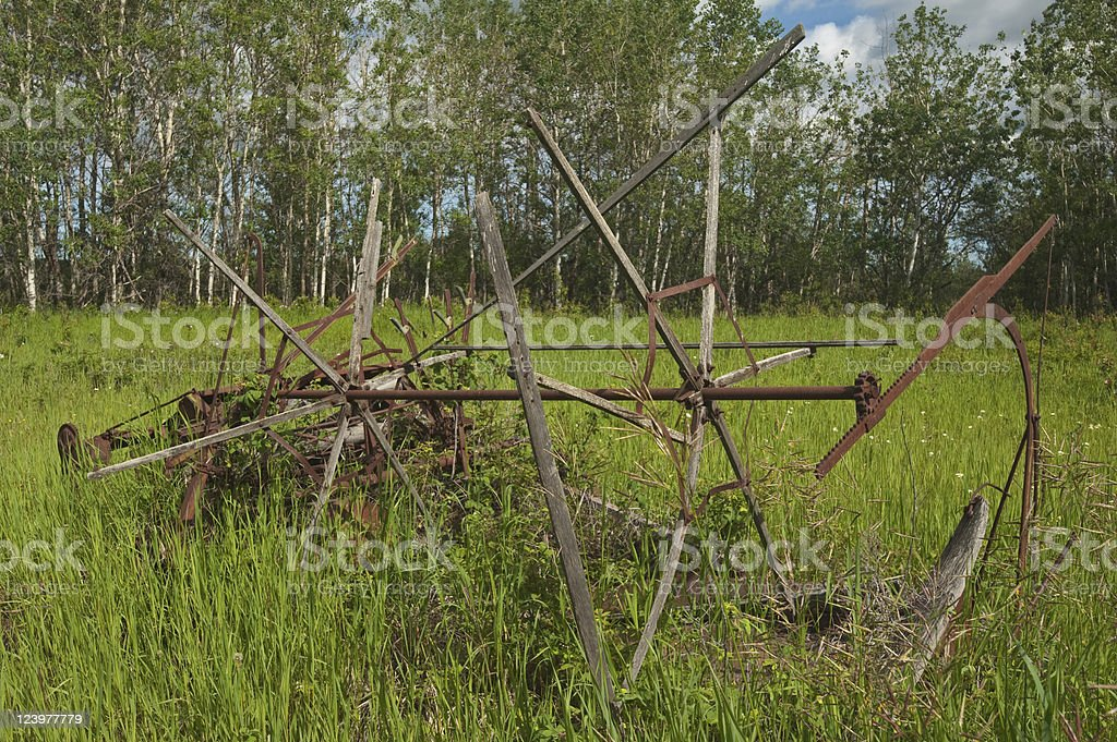 Abandoned Old Antique Farm Equipment Mower Or Cutter Stock Photo