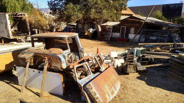 Abandoned old buildings and farm equipment in junk yard on former farm in Redlands California Abandoned old buildings and farm equipment in junk yard on former farm in Redlands California redlands california stock pictures, royalty-free photos & images