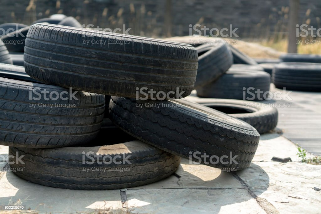 abandoned old car tyres stock photo