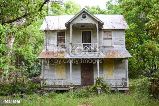 This beautiful old southern style frame vernacular home has seen better days. It is now abandoned and overgrown and in need of restoration.