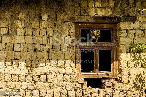 Roztots'ka Pastil', Ukraine - April 25, 2017: Window of an abandoned old house made of adobe on the outskirts of the village in the south-western Ukraine.