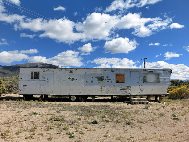 Abandoned old mobile home RV trailer in desert Abandoned old mobile home RV trailer in desert - landscape color photo trailer park stock pictures, royalty-free photos & images