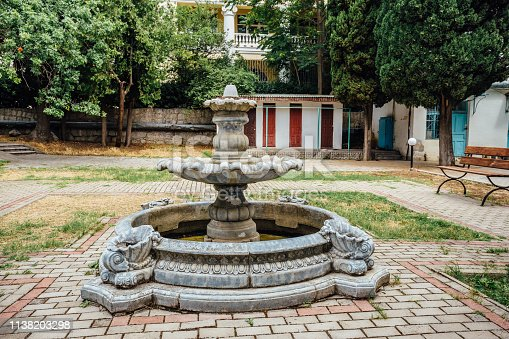 Abandoned old round fountain in old park.