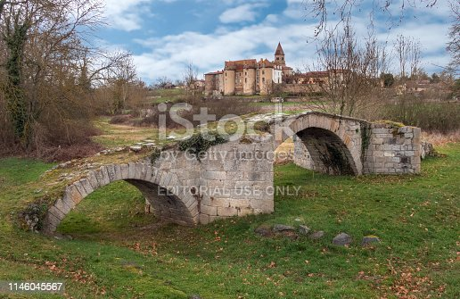 old stone footbridge spans a river that's been diverted in the Rhone Valley, France