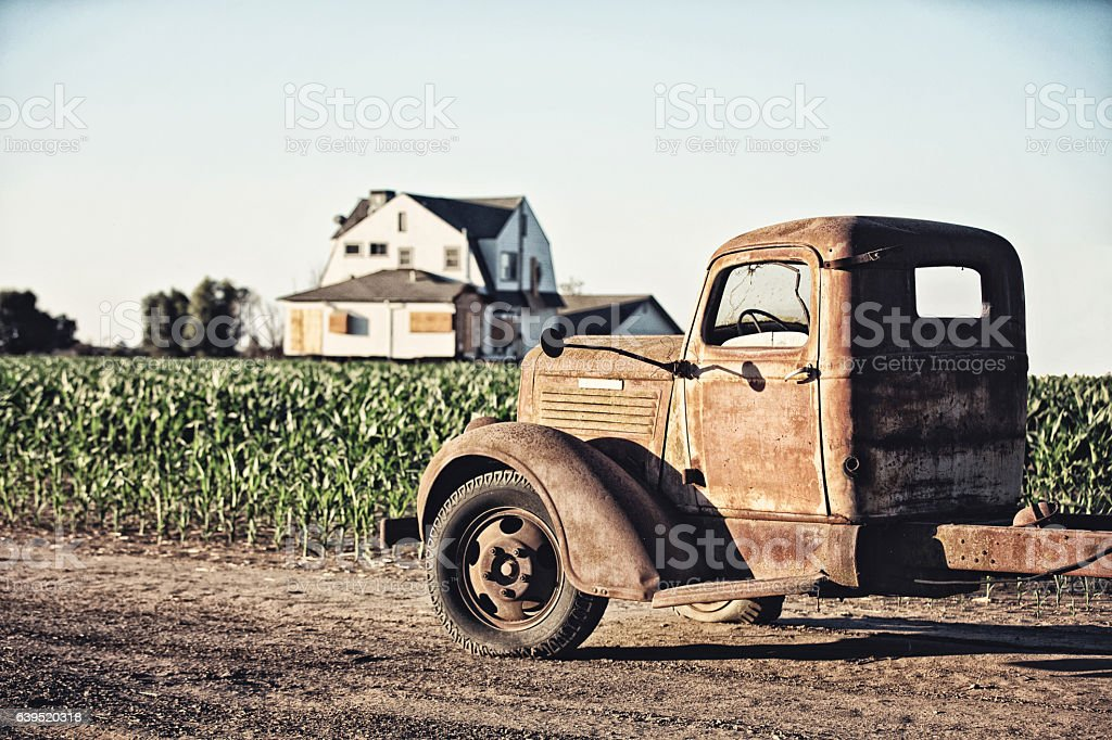 Abandoned Old Truck and Boarded Up Farmhouse stock photo