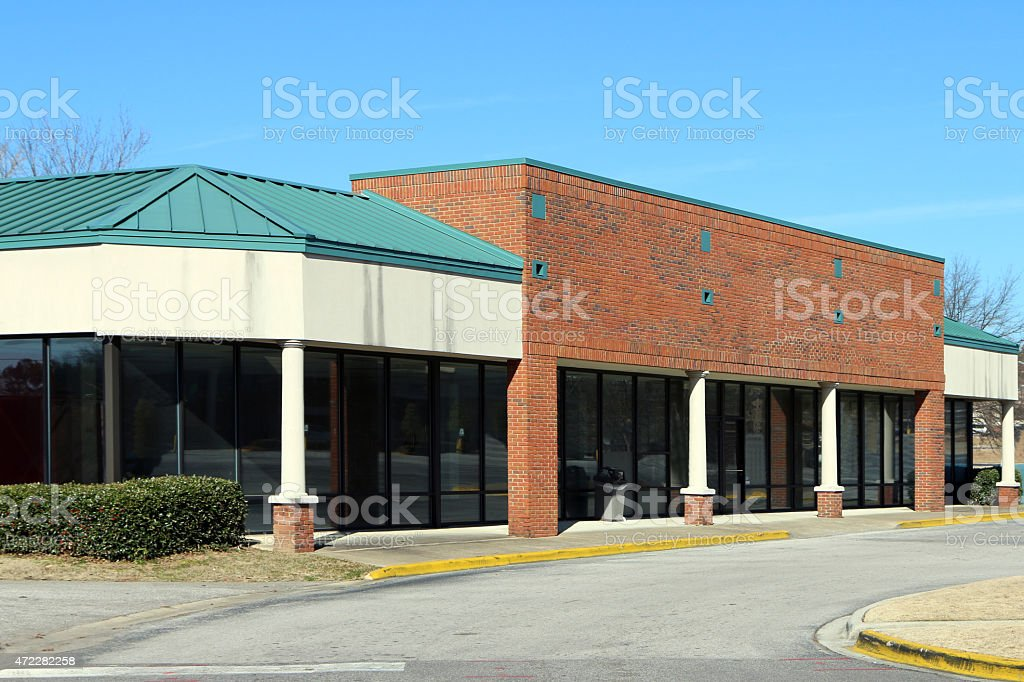 Abandoned or out of business strip shopping center. stock photo