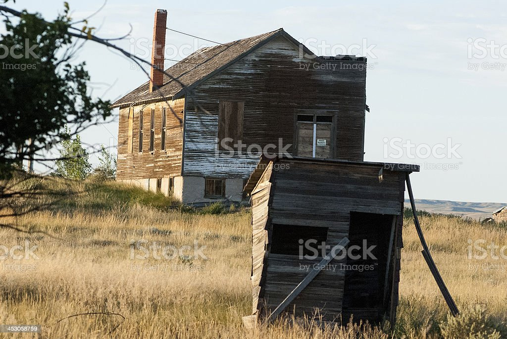 Abandoned Outhouse and schoolbuildings Keota Colorado stock photo