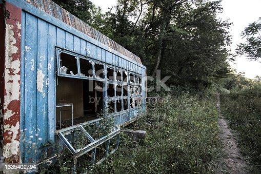 istock Abandoned Overgrown Kiosk 1335402794