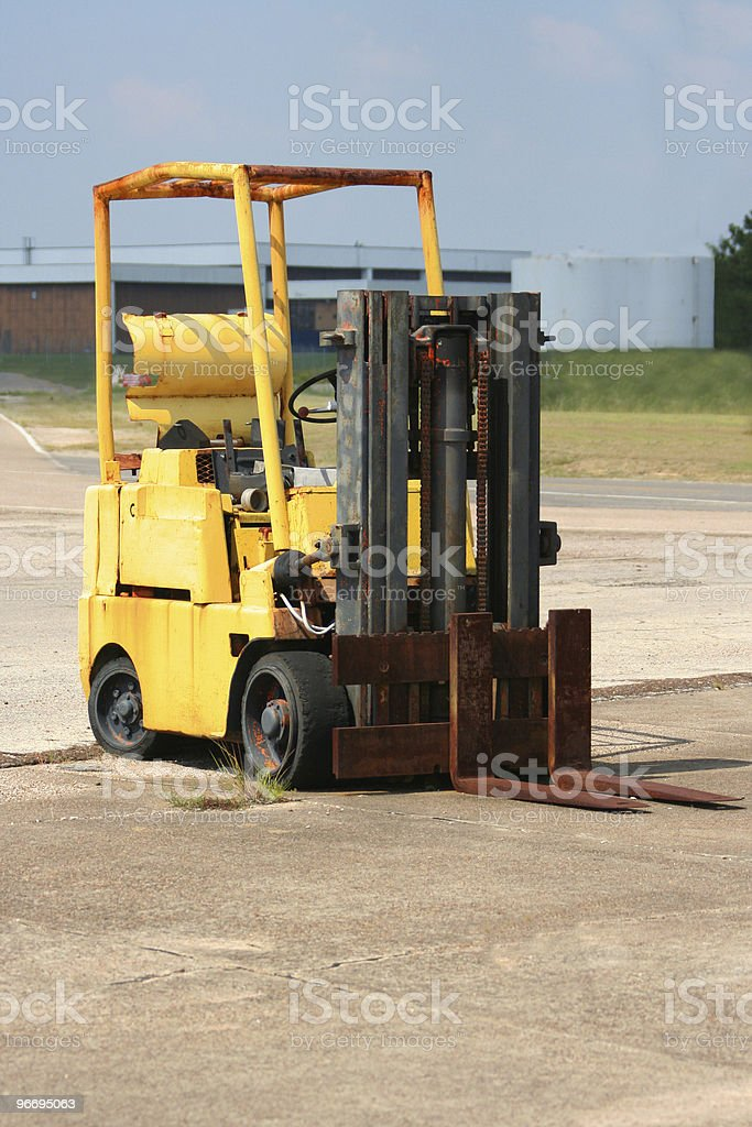 Abandoned, over-used forklift royalty-free stock photo