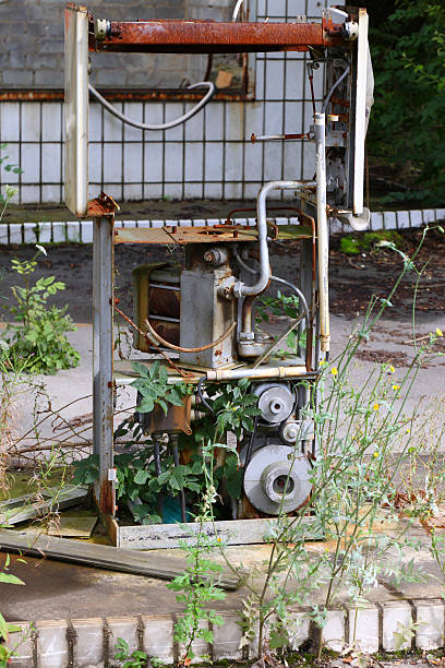 abandoned patrol station Deststroyed fuel pump with weeds dilapidate stock pictures, royalty-free photos & images